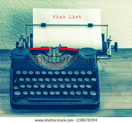 Old typewriter with sample text Wish List. Retro style toned picture - stock photo