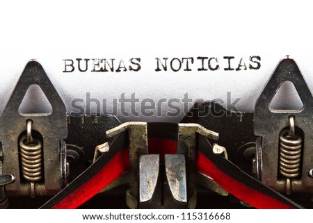 old typewriter with text buenas noticias (good news, in Spanish) - stock photo
