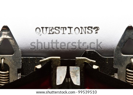 old typewriter with text questions - stock photo