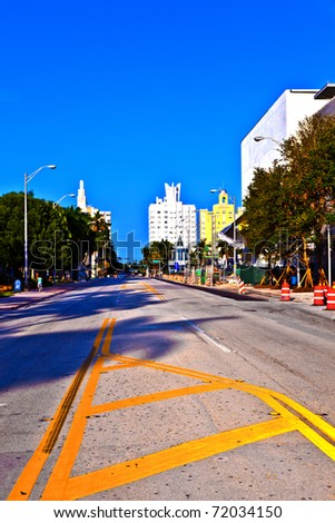 old typical buildings in art deco style downtown South Miami with street and roadwork