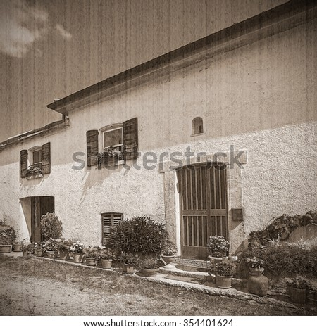 Old typical Tuscan farmhouse in Italy. Old style. Sepia - stock photo