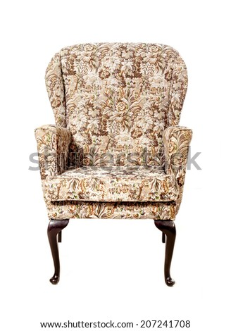Old upholstered chair on a white background. - stock photo