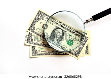 Old 100 US Dollar banknotes under magnifying glass - stock photo
