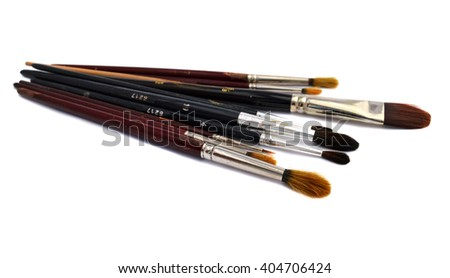 Old Used Artist Brushes in Can on White Canvas Background - stock photo
