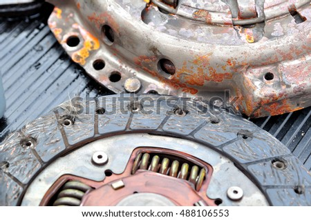 Old used broken car clutch.