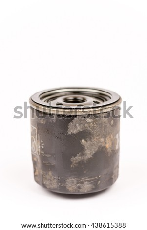 Old used car oil filter isolated over white background - stock photo