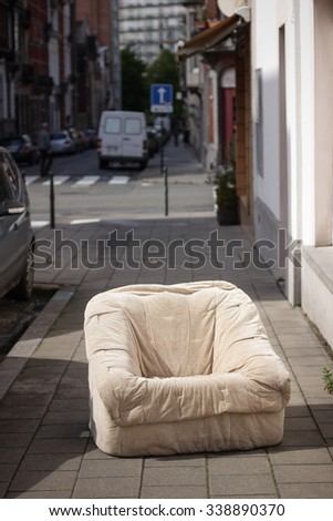 Old used coach chair left on the street. - stock photo