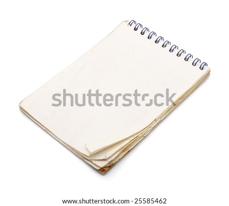 old used notebook on white background with clipping path - stock photo
