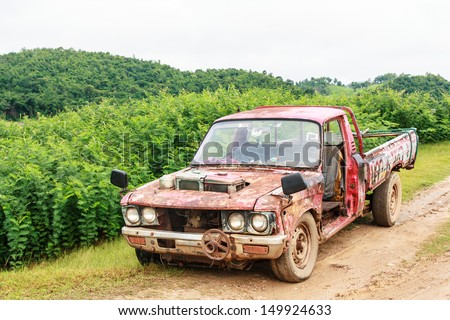 Old used pickup on road in rural of Thailand