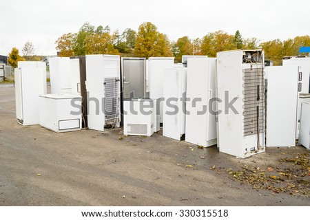 Old used refrigerators and freezers are stored separately in the waste station. Here are some standing together - stock photo