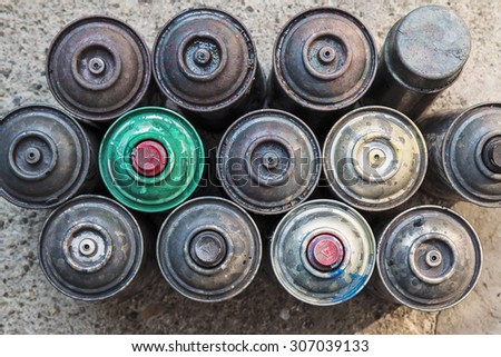 Old used rusty Aerosol Spray cans, ideal background