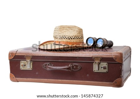 Old used suitcase with Hat and antique Binoculars  isolated on white background.