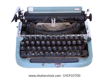 Old used typewriter on a white background