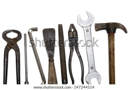 Old used vintage tools over a white background