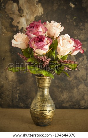 Old vase and flower - stock photo