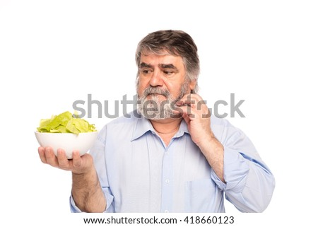 old vegan men holding a bowl of salad in hands, isolated on white