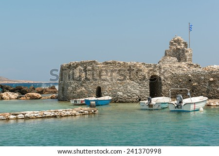 Old Venetian castle in Naoussa village on Paros island - stock photo