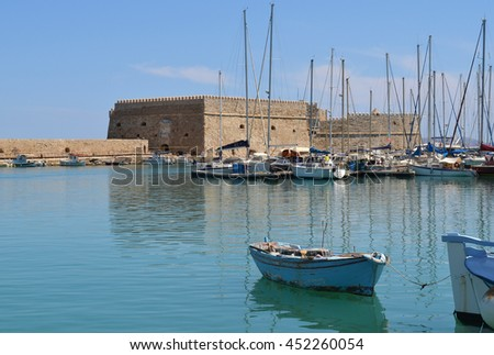 Old Venetian Harbor in Heraklion, Crete, Greece with Koules Fort in the background