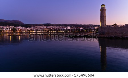 Old venetian harbor with lighthouse at twilight, city of Rethymno, island of Crete, Greece - stock photo