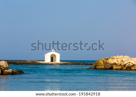 Old venetian lighthouse at harbor in Crete, Greece. Small cretan village Kavros. Travel Background - stock photo