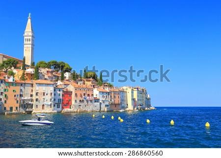 Old Venetian town with small harbor near the Adriatic sea, Rovinj, Croatia - stock photo
