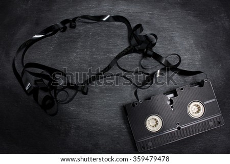 Old vhs video cassette isolated on black background - stock photo