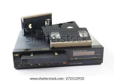Old VHS Video Cassettes on Old Video Recorder Isolated on White Background. - stock photo