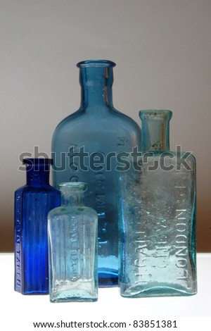 Old Victorian Bottles in Blue. - stock photo