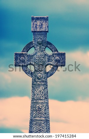 Old Victorian gravestone cross at Cashel cemetery in Ireland processed with colour process filter. - stock photo