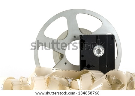 Old video cassette and old movie tapes - stock photo