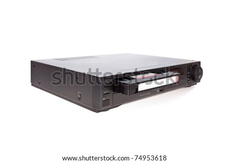 Old Video Cassette Recorder ejecting tape isolated on white background - stock photo