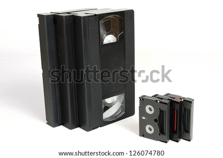 OLD VIDEO CASSETTE TAPES VHS and DV - stock photo