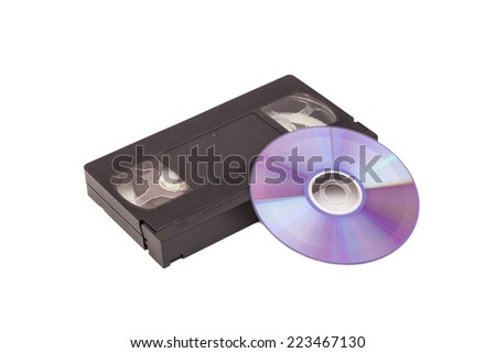 Old Video Cassette tapes with DVD disc isolated on white background