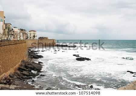 Old village along the coast of Sardinia - stock photo