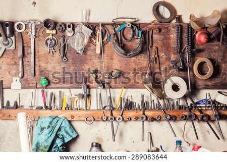 Old vinrtage tools on the wall - stock photo