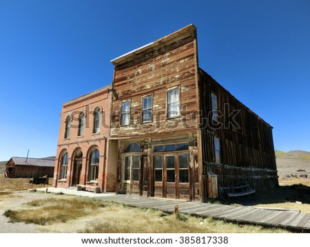 Old vintage abandoned weathered buildings in Bodie, California - landscape color photo - stock photo