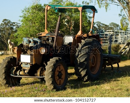 old vintage Australian tractor used for farm work on ranch in agriculture in Australia