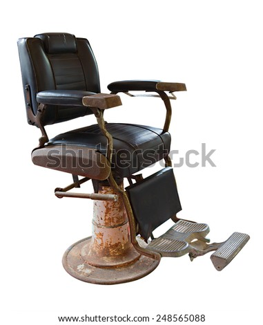 Old Vintage barber chair on white background - stock photo