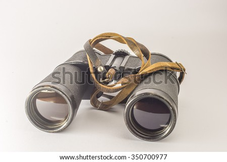 Old vintage binoculars. Isolated.