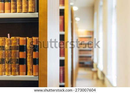 Old Vintage Books On A Wooden Shelfs In Library. Education Concept - stock photo