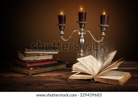 Old vintage books with candles in candlestick. Old retro style