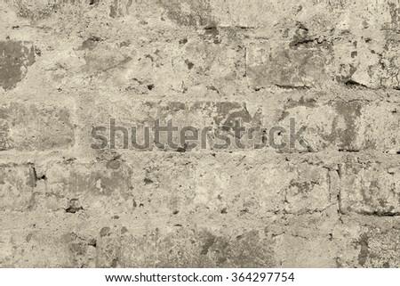 Old vintage brick wall background bw sepia - stock photo