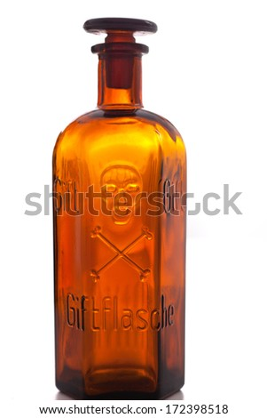 Old vintage brown glass pharmacy bottle marked Poison and engraved with a skull and crossbones with a matching glass stopper isolated on white - stock photo