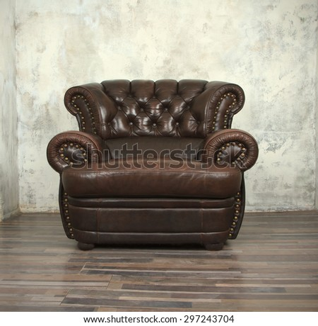 old vintage brown leather chair in empty room - Brown Leather Recliner