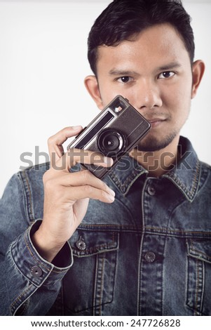 old vintage camera in hand - stock photo