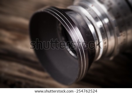 Old vintage camera on a wooden background. - stock photo