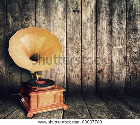 Old vintage CD player in the Vintage wooden room - stock photo
