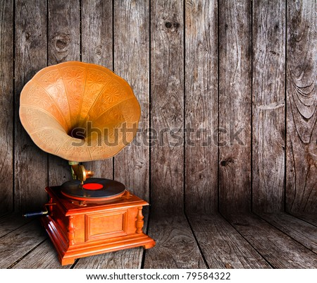Old vintage cd player in wooden room - stock photo