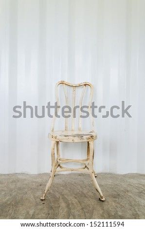 Old vintage chair on gray wall