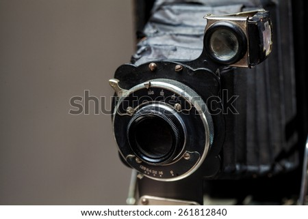 Old vintage classic camera on gray background - stock photo